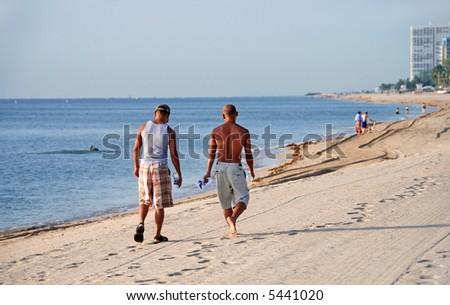 Gay couple on beach - stock photo