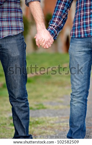 Gay Couple Outside Holding Hands, Italy - stock photo