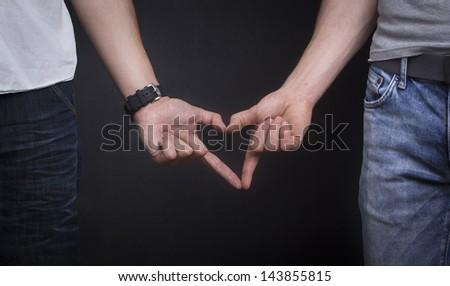 Gay couple showing love - stock photo