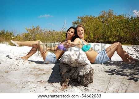 Gay couple sitting on a sand