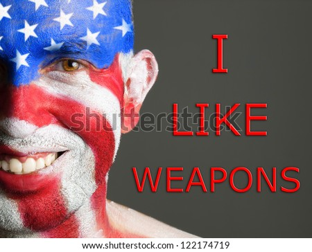 "Gay flag painted on the face of a man. Man is looking at camera and is smiling. The word ""pride"" is write at one side. - stock photo"