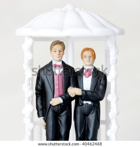 Gay marriage illustrated with two male figures - stock photo