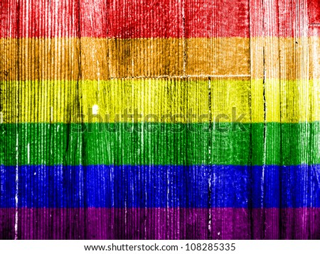 Gay pride flag painted on wooden pad - stock photo