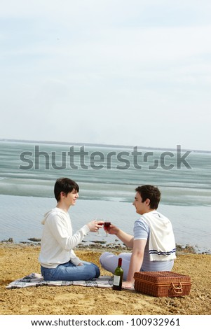 Gays being on a romantic beach date at seaside