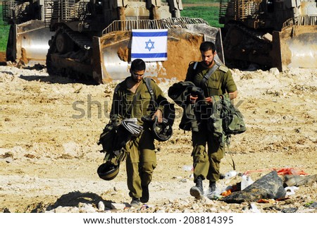 GAZA STRIP - JAN 18 2009:Israeli soldiers partially withdraw from Gaza into Israel, as both Hamas and Israel announce separate cease-fires. - stock photo