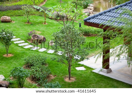 Gazebo and footpath landscaping  in a beautiful garden - stock photo