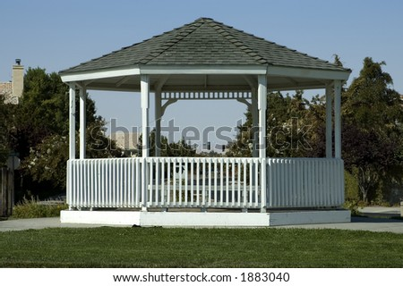 Gazebo in a neighborhood park. - stock photo