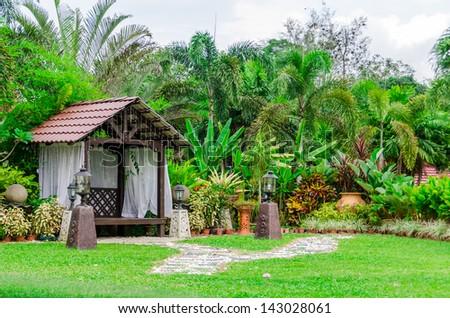 Gazebo in landscaped garden - stock photo