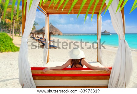 gazebo tropical beach with woman rear view looking sea from a tropical resort [ photo-illustration ] - stock photo