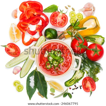 Gazpacho soup and ingredients isolated on a white, top view. - stock photo