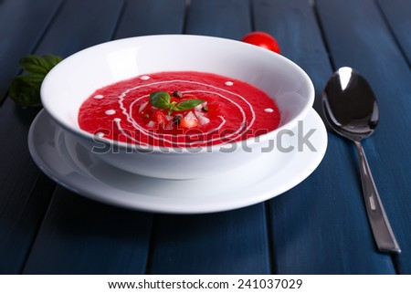 Gazpacho soup on color wooden background - stock photo