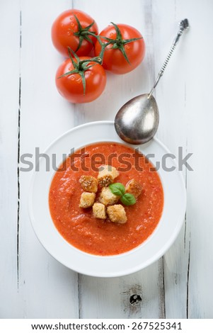 Gazpacho with croutons over white wooden background, above view - stock photo
