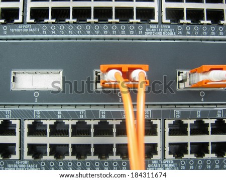 GBIC fiber optic communications switch equipment installed in large data center.