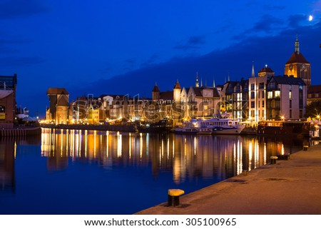 Gdansk old town and famous crane, Polish Zuraw. View from Motlawa river, Poland at romantic night. The city also known as Danzig and the city of amber. - stock photo