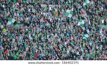 GDANSK, POLAND - APRIL 05, 2014: Joy supporters of Lechia Gdansk after scoring a goal during match Polish Premier League between Lechia Gdansk - KGHM Zaglebie Lubin (2:1) - stock photo
