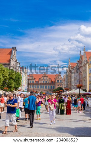 GDANSK, POLAND - APRIL 01: People visitors Long Street on April 1, 2014 in Gdansk, Poland. Street is one of the most notable tourist attractions of the city.