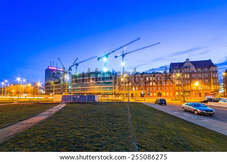 GDANSK, POLAND - FEBRUARY 21, 2015: Building construction of Tryton office building in Gdansk, Poland. Tryton Business House will be modern glass building with 22 000 square meters of office space. - stock photo