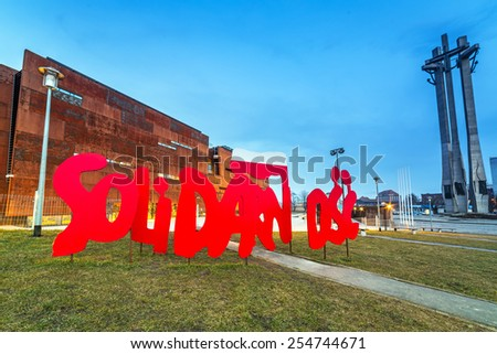 GDANSK, POLAND - FEBRUARY 21, 2015: Solidarnosc sign under European Solidarity Centre in Gdansk, Poland. The ECS museum located at the docyard is a memorial of anti-communist opposition in Poland. - stock photo