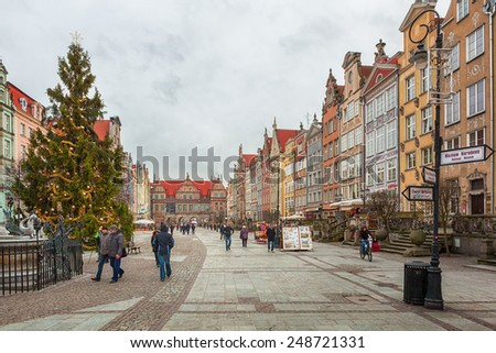 GDANSK, POLAND - JANUARY 15 2015 : Tourists and locals walking on streets in historical center of Gdansk city, Poland - stock photo