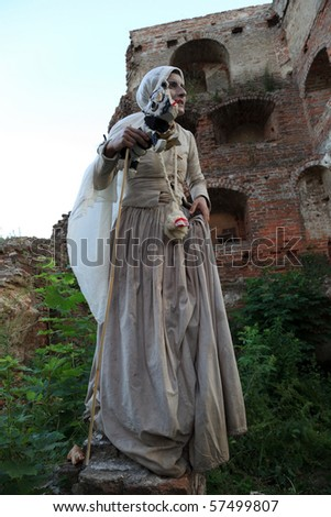 GDANSK, POLAND - JULY 16: A female actor participates in the XIV International Festival of Street FETA on July 16, 2010 in Gdansk, Poland. 28 theaters from 15 countries showed 31 performances. - stock photo