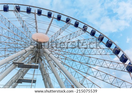 GDANSK, POLAND - 25 JULY 2014: Ferris wheel in Gdansk at night with promenade at Motlawa river. Gdansk is the historical capital of Polish Pomerania with medieval old town architecture.