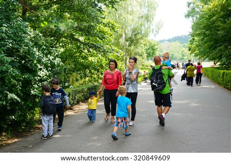 GDANSK, POLAND - JULY 28, 2015: People walking on a footpath at the Olivia zoo