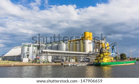 GDANSK, POLAND - JULY 11: Ship at the bulk terminal on July 11, 2013 in the Port of Gdansk, the largest seaport in Poland, major transportation hub in the central part of the southern Baltic Sea coast