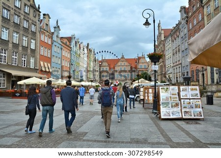 GDANSK, POLAND - JUNE 27, 2015: People on Dluga street in old town. Gdansk has the main seaport in Poland and is popular destination for tourists - stock photo