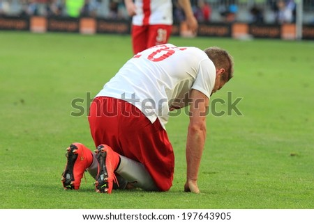 GDANSK, POLAND - JUNE 6: Polish right back defender Lukasz Piszczek during the friendly football match between Poland and Lithuania on June 6, 2014 in Gdansk, Poland. Final result: 2:1  - stock photo