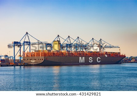 GDANSK, POLAND-JUNE 03, 2016:The MSC Maya is currently one of the world's largest container ship during loading at DCT Gdansk Container Terminal. Length 395m, beam 59m, total capacity 19224 containers