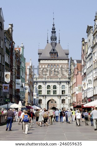 Gdansk, Poland - June 21, 2013: Tourists in front of the Golden Gate in the Long Street from Gdansk in Poland. - stock photo