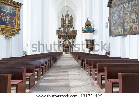 GDANSK, POLAND - 12 MARCH 2013: Interiors of St. Mary's Basilica in Gdansk on 12 March 2013. This Roman Catholic church built in 1379 is the largest brick church in the world. - stock photo