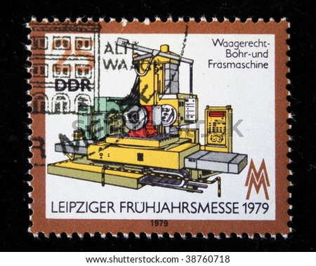 GDR -CIRCA 1979: A stamp printed in GDR (East Germany) shows metall working mashine, honoring Leipzig Trade Fair, circa 1979