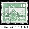 "GDR - CIRCA 1973: A stamp printed in GDR (East Germany) shows Neptune Fountain and City Hall Street, Berlin with the same inscription, from the series ""Landmarks in GDR"", circa 1973 - stock photo"