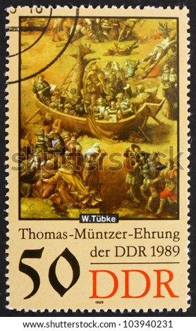 GDR - CIRCA 1989: a stamp printed in GDR shows Ark, Detail of the Painting Early Bourgeois Revolution in Germany in 1525 by Werner Tubke, circa 1989 - stock photo