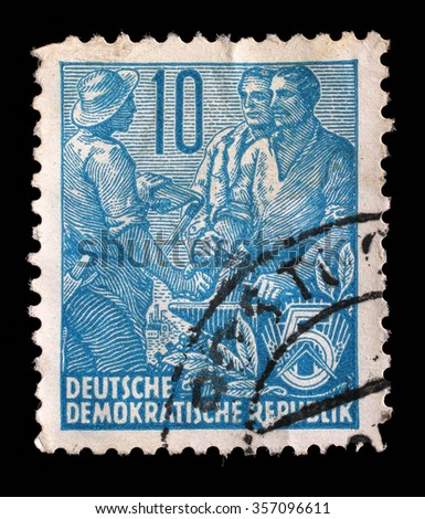 GDR - CIRCA 1955: A stamp printed in GDR, shows Farmer, worker, intellectuals, series Five-year plan, circa 1955 - stock photo