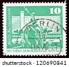 GDR - CIRCA 1973: a stamp printed in GDR shows Neptune Fountain, City Hall Street, Berlin, circa 1973 - stock photo