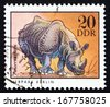 GDR - CIRCA 1975: a stamp printed in GDR shows Rhinoceros, Berlin, German Zoological Garden, circa 1975 - stock photo