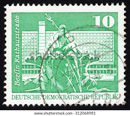 GDR - CIRCA 1973: post stamp printed in East Germany (DDR) shows Neptune fountain City Hall Street Berlin (Rathaus); Scott 1431 A449 10pf green emerald; circa 1973