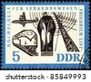 GDR - CIRCA 1962: stamp printed in GDR (East Germany), shows passenger ship, airplane, train and radio-mast, devoted to the Transportation Institute, circa 1962 - stock photo