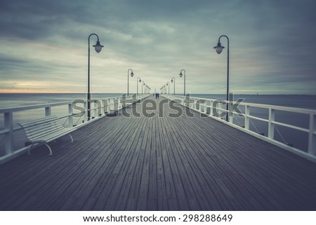 Gdynia Orlowo pier. Vintage photo of Baltic sea shore seascape. - stock photo