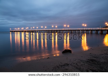 Gdynia Orlowo pier. Vintage photo of Baltic sea shore seascape. Sunrise at seaside - stock photo