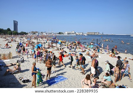 GDYNIA, POLAND - JULY 26, 2012: Crowded Municipal beach in Gdynia, Baltic sea, Poland - stock photo