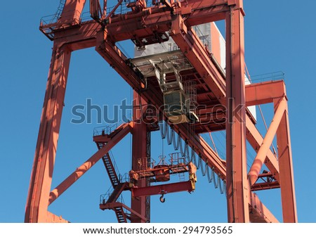 GDYNIA, POLAND - JUNE 13, 2015: Giant crane with operators seat in containers port