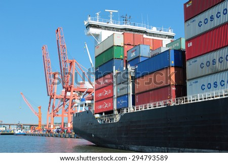GDYNIA, POLAND - JUNE 13, 2015: Loaded container ship in port of Gdynia, Poland - stock photo