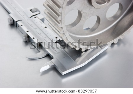 gear and callipers on a metal plate