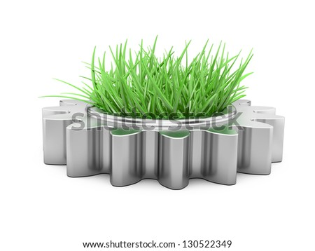 gear and grass inside. Concept of preservation of natural resources at development of the industry - stock photo