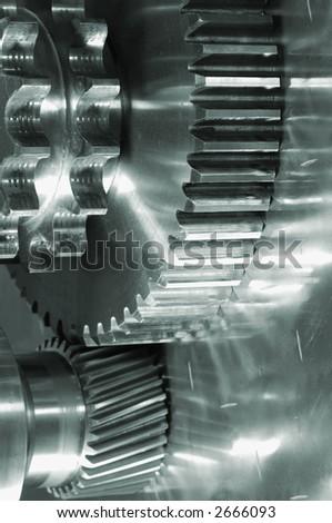 gear-machinery concept against titanium, all in a green metallic tone - stock photo
