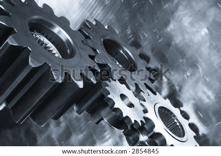 gear-machinery reflecting in steel and in metallic blue cast