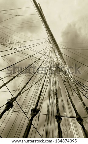 Gear old sailing ship on the background of an overcast sky - Turku, Finland (stylized retro) - stock photo